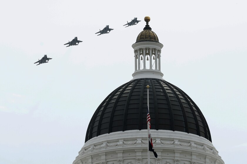 Four fighter jets fly over the dome of California's state Capitol.