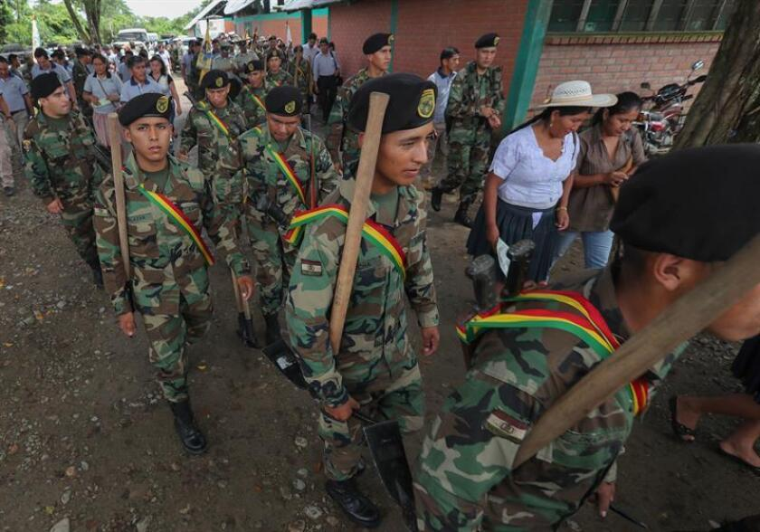 Members of Bolivian Joint Task Force attend the closing of eradication of illegal coca leaves crops program, in Chimore, Bolivia, Dec. 20, 2018. Morales announced that the Bolivian government eradicates through peaceful means 11,173 hectares of illegal coca leaf crops. EPA-EFE/Martin Alipaz