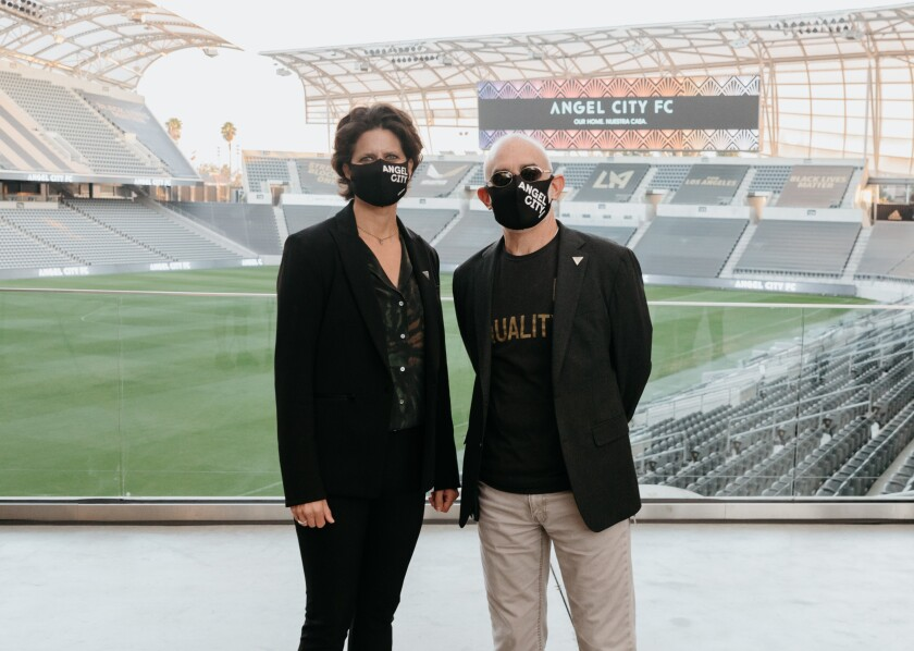 Angel City president Julie Uhrman, left, and LAFC co-owner Larry Freedman stand together.