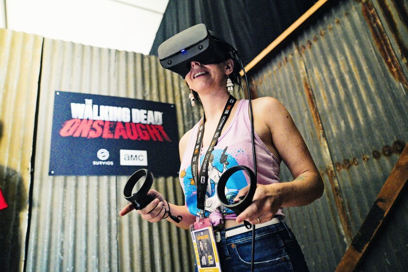 """U-T reporter Lyndsay Winkley takes a virtual reality game for a test drive at """"The Walking Dead"""" exhibit at Comic-Con."""