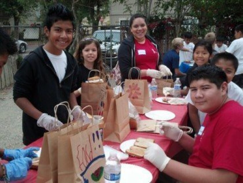 Making sack lunches for Bread Of Life Rescue Mission