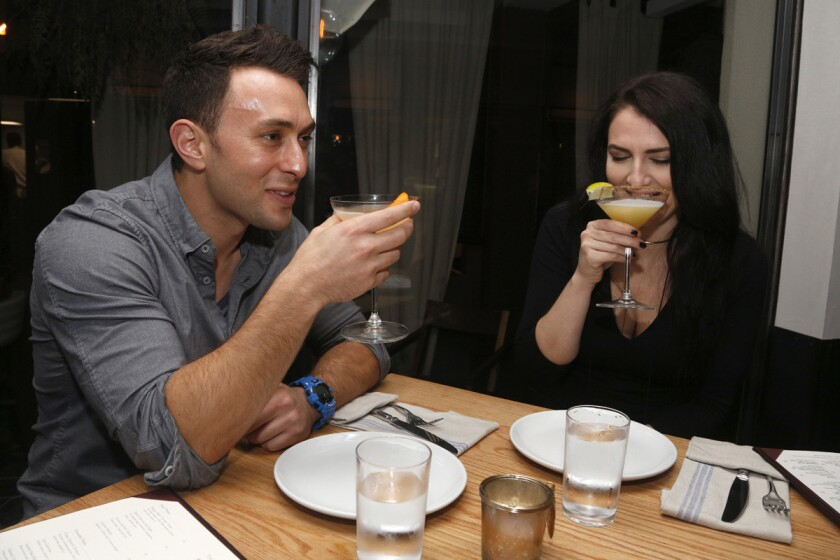 Blind daters Scott Schindler and Zlata Sushchik enjoying their cocktails at The Hake.