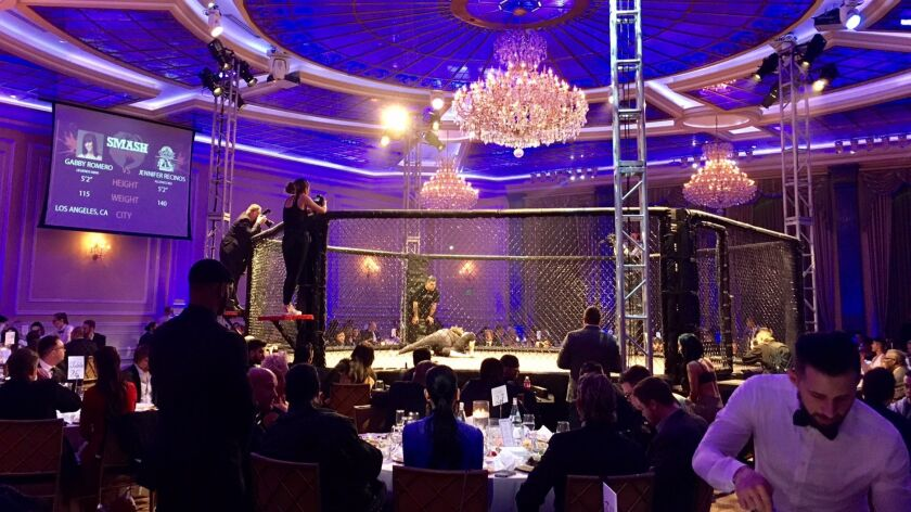 Guests dine ringside as MMA fighters brawl at the SMASH Global Pre-Oscars gala.