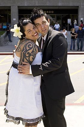 Cesilia and Santiago Miranda were married recently at the courthouse in Norwalk. They followed a trend of brides and grooms choosing courthouse weddings to save money. More in Image: • Simple weddings: Get me to the courthouse on time | Photos • Wedding dresses go back to basics | Photos • Bridal wear: The $100 wedding challenge | Photos • A wedding with all the (budget) trimmings • The right wedding tuxedo is a matter of timing • Vintage headbands add a quirky touch to a wedding ensemble