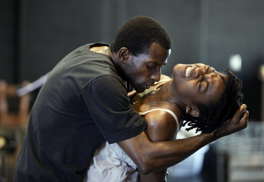 "Kola Ogundiran (left) and Pascale Armand rehearse a scene from La Jolla Playhouse's ""Ruined."""