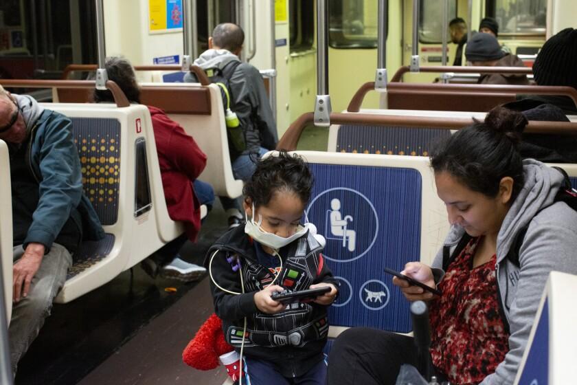 Commuters ride the The Los Angeles Metro Metro D Line. (Gabriella Angotti-Jones/Los Angeles Times)