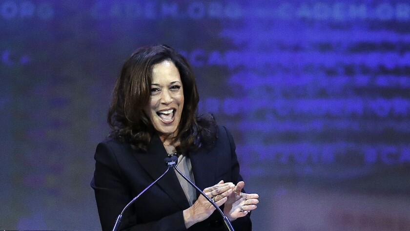 Atty. Gen. Kamala Harris applauds at the California Democratic Partyconvention.