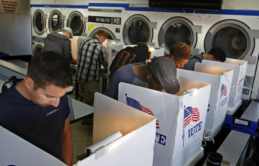 Voting at Super Suds laundromat