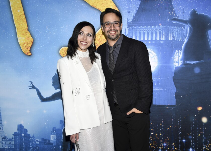 """Actor Lin-Manuel Miranda, right, and wife Vanessa Nadal attend the world premiere of """"Cats"""" at Alice Tully Hall on Monday, Dec. 16, 2019, in New York. (Photo by Evan Agostini/Invision/AP)"""