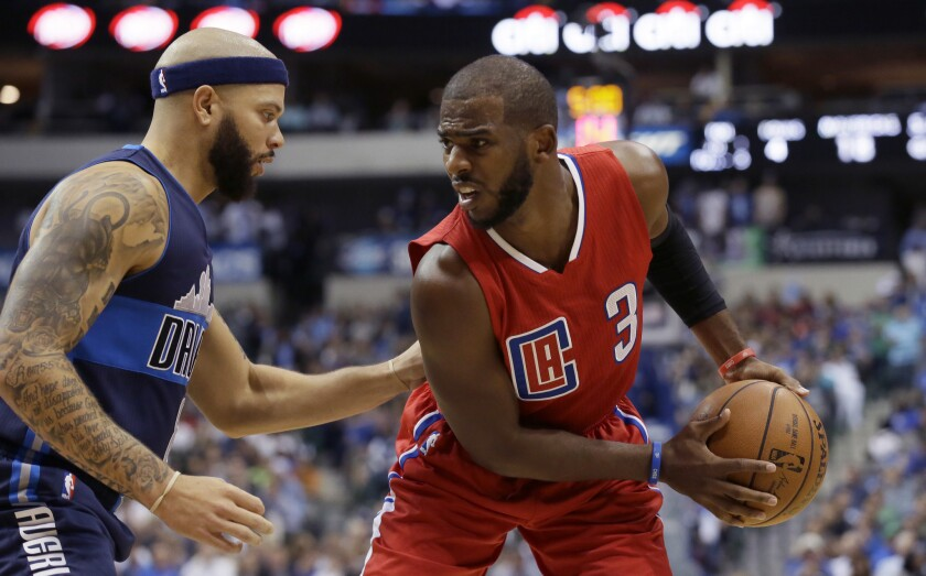 The Clippers' Chris Paul is defended by the Mavericks' Deron Williams during a Nov. 11 game in Dallas.