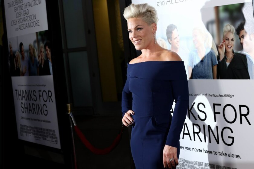 "Pop singer Pink says her young son's COVID-19 symptoms ""scared the bejesus"" out of her."