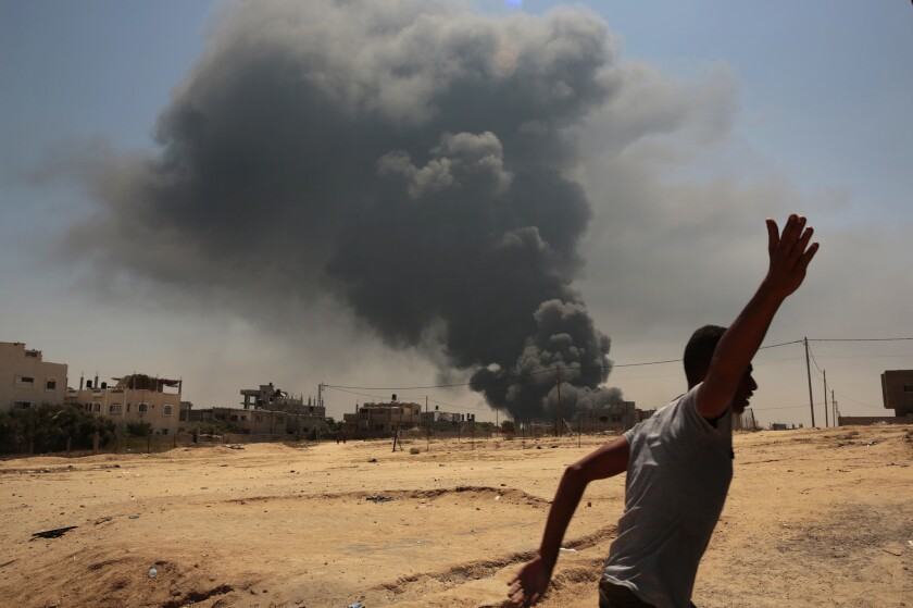 After a night of heavy bombardment by Israeli forces, smoke rises from a power plant outside the town of Bureij in the Gaza Strip on July 29, 2014.