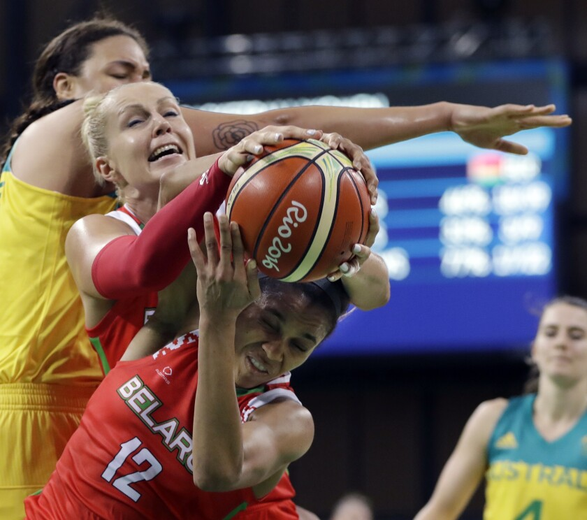 FILE - In this Aug. 13, 2016, file photo, Belarus guard Lindsey Harding (12) controls the rebound next to teammate Yelena Leuchanka, center, and Australia center Liz Cambage, rear, during the second half of a women's basketball game at the Youth Center at the Summer Olympics in Rio de Janeiro, Brazil. It has been a difficult last few months for former Belarus star basketball player Leuchanka. She spent 15 days in jail in October after peacefully protesting against President Alexander Lukashenko's disputed re-election and then contracted the coronavirus earlier this month while she has been in Greece. (AP Photo/Carlos Osorio, File)