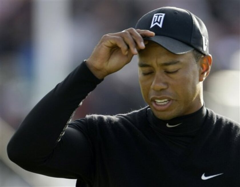 Tiger Woods of the US reacts after putting on the 18th green during the second round of the British Open Golf championship, at the Turnberry golf course, Scotland, Friday, July 17, 2009. (AP Photo/Matt Dunham)