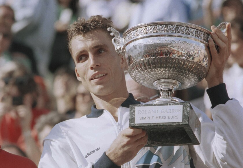 """FILE - In this June 9, 1986, file image top-seed Ivan Lendl holds his trophy in Paris after winning the French Open tennis tournament with his victory over Sweden's Mikael Pernfors. Lendl beat Pernfors 6-3, 6-2, 6-4. Lendl was on the receiving end of the most famous underarm serve in tennis history, when a cramping Michael Chang used one to win a point in the fifth set of their fourth-round match at Roland Garros in 1989. Underarm serves are being used by some players at this year's French Open and there is some discussion about whether they are a legitimate tactic. Lendl tells the AP they're """"perfectly fine."""" (AP Photo/Pierre Gleizes, File)"""