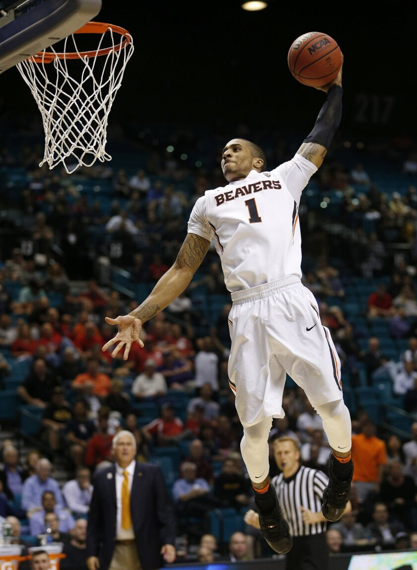 Oregon State guard Gary Payton II dunks against Arizona State during the second half of an NCAA college basketball game in the first round of the Pac-12 men's tournament Wednesday, March 9, 2016, in Las Vegas. (AP Photo/John Locher)