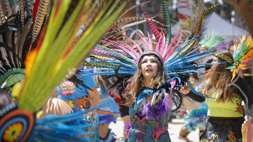 Dancers in traditional Aztec garb performed during the 48th Chicano Park Day in San Diego's Barrio Logan.