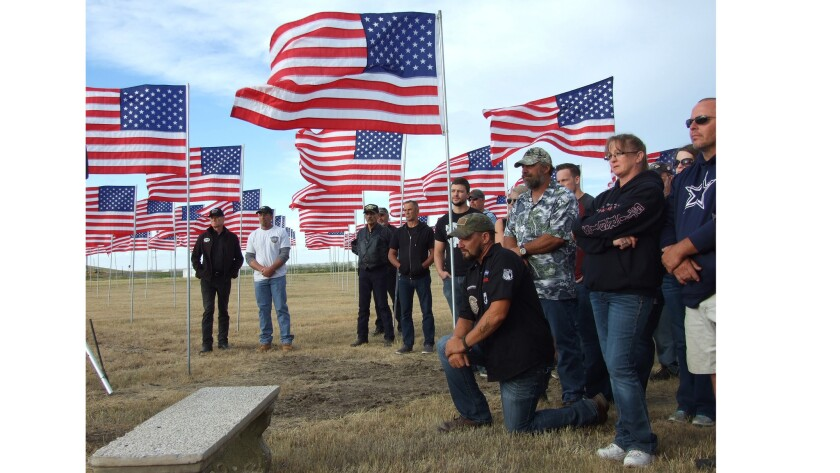 Locals gather July 1 at the Buffalo Chip Campground's Field of Flags near Sturgis, S.D., for a ceremony honoring veterans.