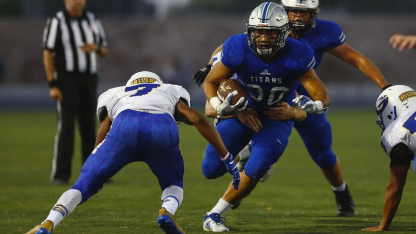 Eastlake's Parker Merrifield will help power the ground game as the Titans try to win their 10th straight game.