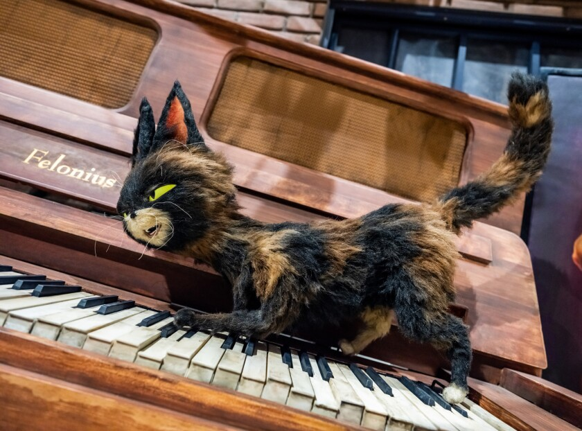 """One of the most complex animations in Universal's ride inspired by """"The Secret Life of Pets"""" is an alley cat playing a piano."""