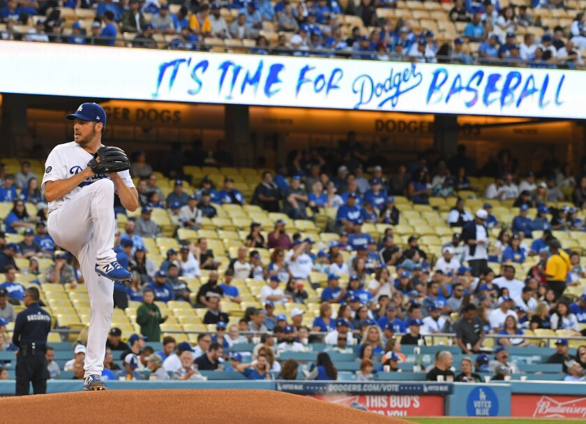 Dodgers pitcher Rich Hill warms up before a game against the San Francisco Giants on June 19.