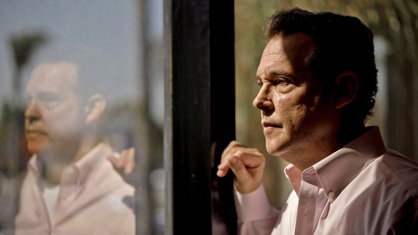 Alex Meruelo, a longtime L.A. investor, peers out the window of his offices in Downey. He is the new owner of the SLS Las Vegas, a historic but troubled casino on the Las Vegas Strip.