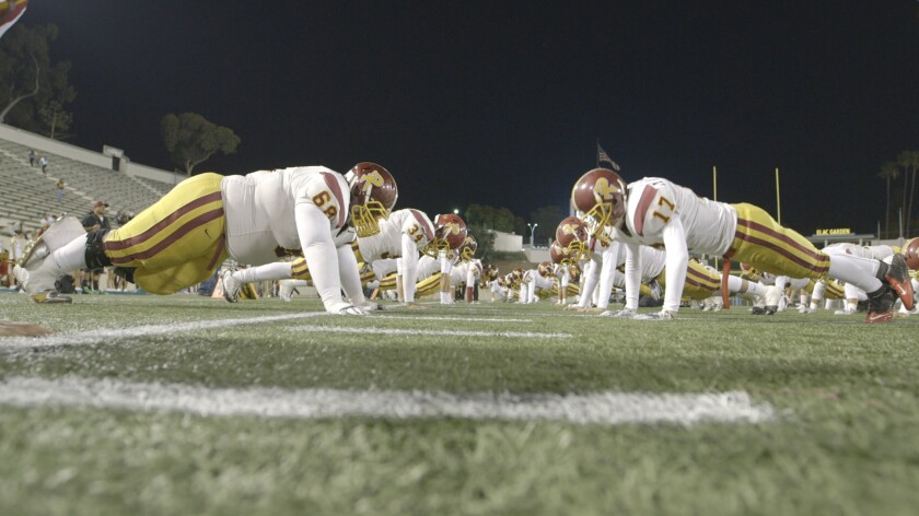 Roosevelt High School football players prepare to face Garfield High School in the East L.A. Classic in the documentary 'The All-Americans'