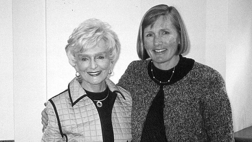 College Park Elementary School Principal Julie McCormick, right, pictured in 2003 with her mother, former state legislator Marian Bergeson, will be transferred to Newport Coast Elementary by next school year, according to the Newport-Mesa Unified School District.