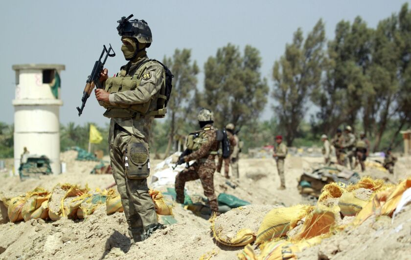 Iraqi government forces take position in the Jarf Sakhr area on May 24, trying to protect the region from Islamic State advancement.