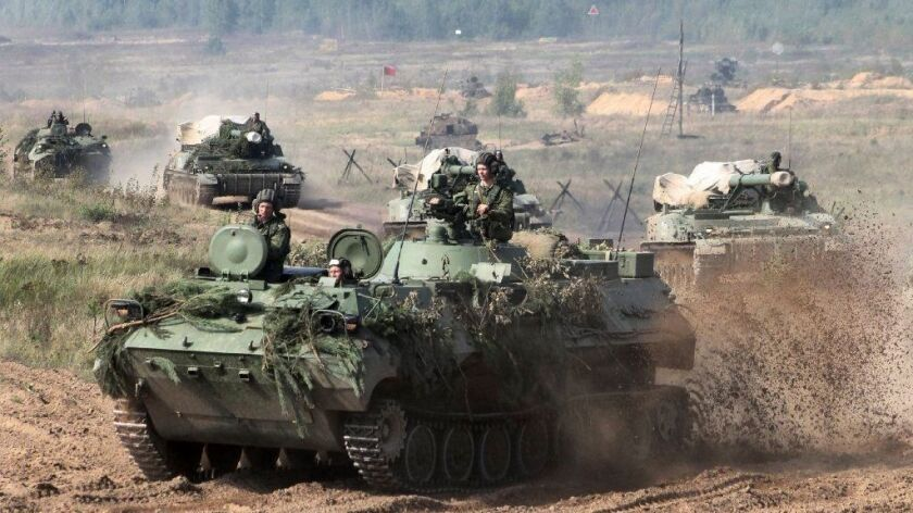 In this photo taken on Monday, Sept. 11, 2017, Belarusian army vehicles drive preparing for war game