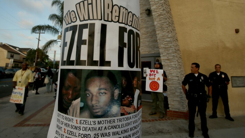 A flier bearing the likeness of Ezell Ford a light pole outside Paradise Baptist Church in South Los Angeles, where a community forum was held on the shooting.