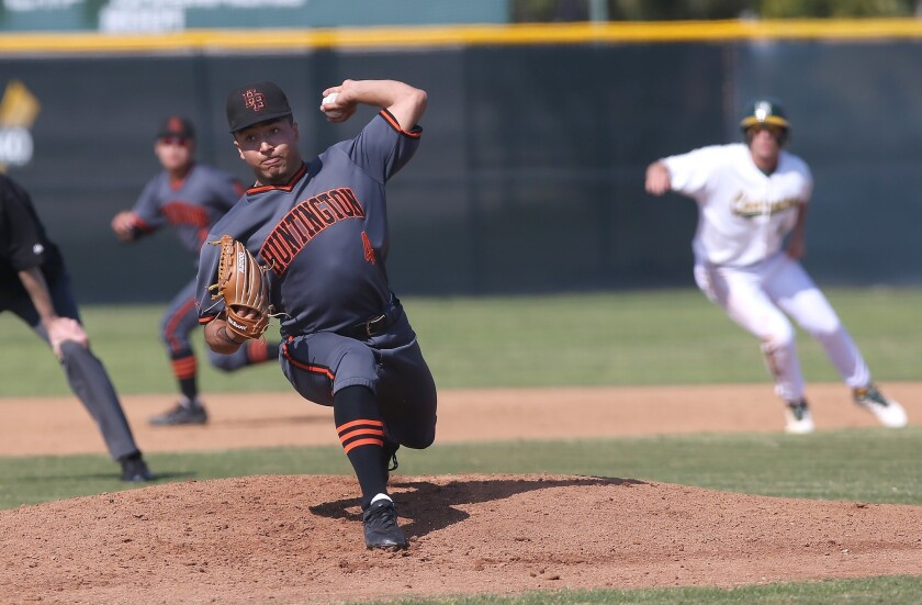 Starting pitcher Eddie Pelc (4) of Huntington Beach, throws a pitch during Surf League baseball game