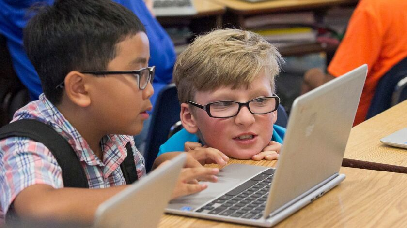 Circle View Elementary student Nolan Neves, right, takes a closer look at what classmate David Tran