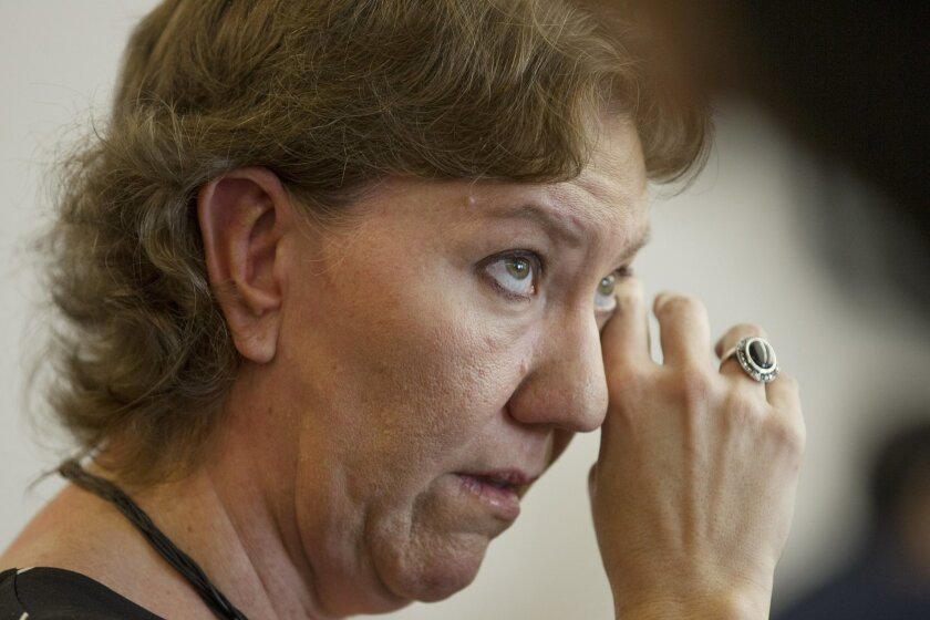 Plaintiff Christy O'Donnell, who has lung cancer, wipes away the tears during a hearing in Superior Court on Friday in San Diego, California. The judge ruled that existing state law, which prohibits any person from deliberately aiding, advising or encouraging a person to commit suicide, is constit