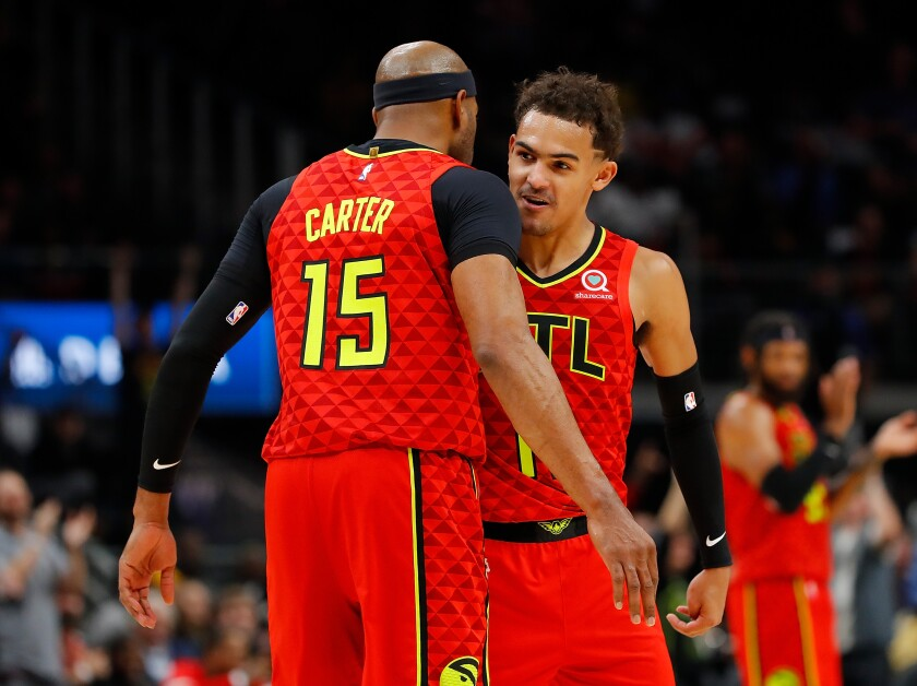 Vince Carter celebrates with his younger Hawks teammate Trae Young after a shot against the Spurs during a game Nov. 5.