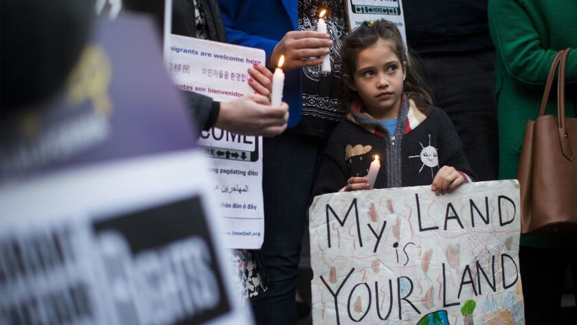 Maya Casillas, 7, joins a protest at Los Angeles City Hall against President Trump's immigration executive orders.