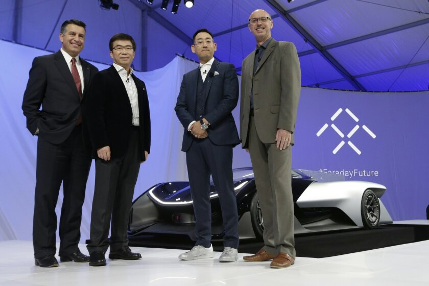 File - In this Jan. 4, 2016 file photo, Nevada Gov. Brian Sandoval, left, poses for a photo in front of the FFZero1 by Faraday Future, alongside members of the Faraday Future team at CES Unveiled, a media preview event for CES International in Las Vegas. A Nevada board gave final approval Friday to tax incentives to attract electric carmaker Faraday Future to Nevada, formalizing a deal that state lawmakers authorized in a special session last month. From right are Nick Sampson, product developer, Richard Kim, head of global design, Ding Lei, and letv co-founder. (AP Photo/Gregory Bull, File)