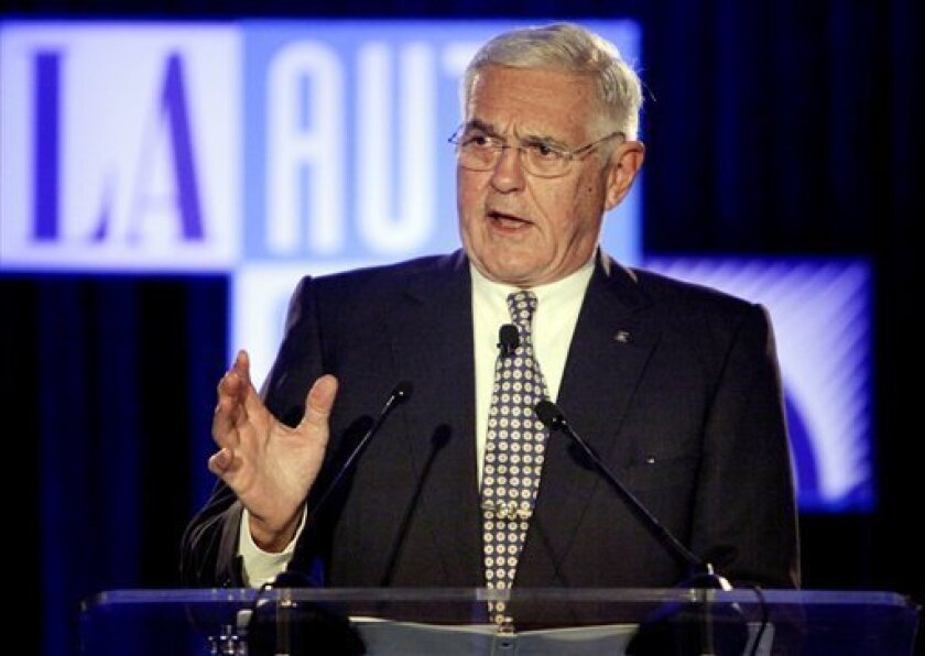 FILE - In this Dec. 2, 2009 file photo, GM Vice Chairman Bob Lutz delivers a keynote speech at the Los Angeles Auto Show in Los Angeles. New CEO Ed Whitacre Jr. is shaking up GM's numbers-oriented bureaucracy. In a folksy, self-deprecating broadcast to employees, he says they're free to take risks without fear of being fired. (AP Photo/Jae C. Hong, file)