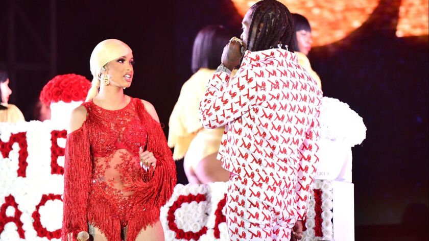 Offset, right, is defending his actions after interrupting estranged wife Cardi B's set at Rolling Loud over the weekend.