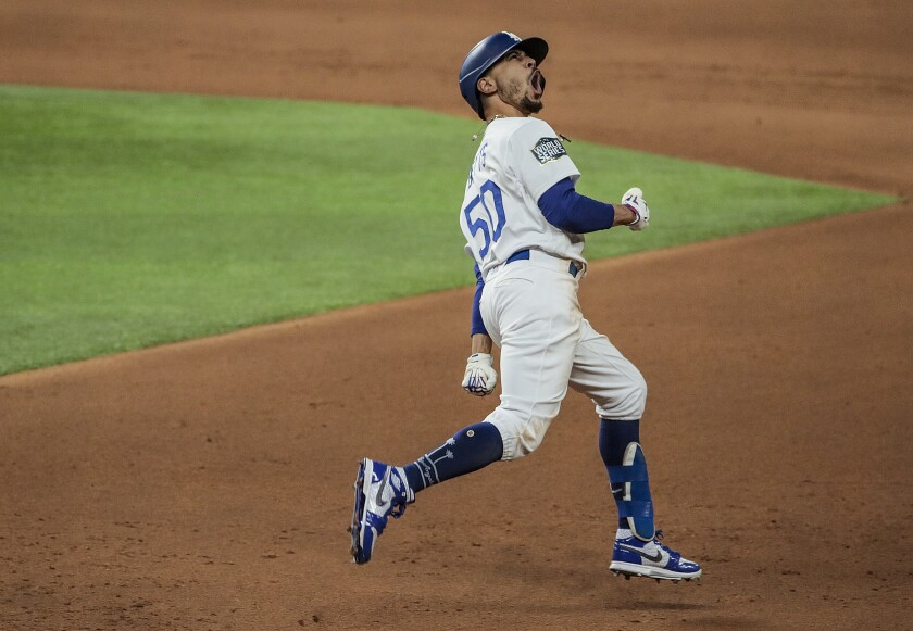 Dodgers right fielder Mookie Betts celebrates after hitting a home run in the World Series