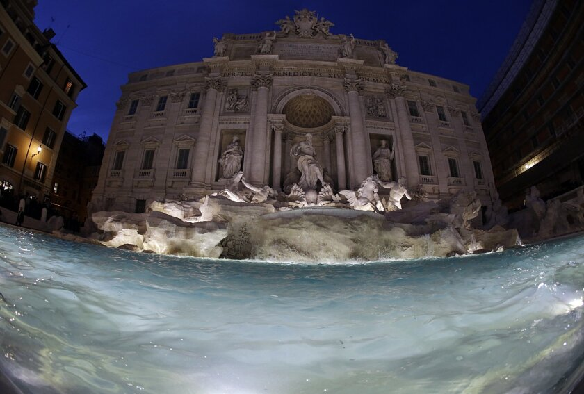 """The newly restored Trevi Fountain is lit during the official inauguration in Rome, Tuesday, Nov. 3, 2015. The historical fountain, famed as a setting for the film """"La Dolce Vita'' and the place where dreamers leave their coins, reopened after a 17-months restoration financed by the Fendi fashion ho"""