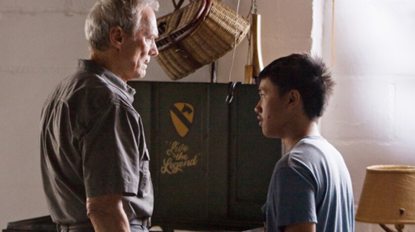 SOFTENING: Walt Kowalski (Clint Eastwood), left, is drawn into the plight of the fatherless Thao (Bee Vang).