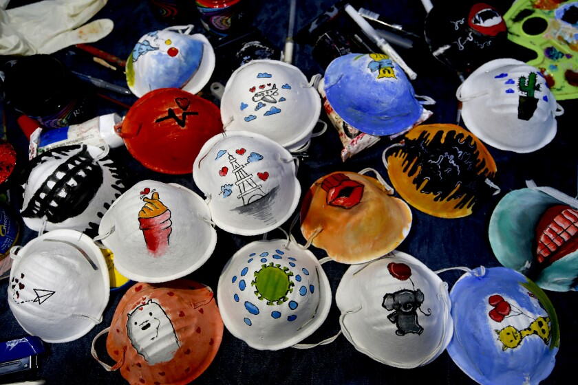 This picture shows N95 protective masks painted by Palestinian artists Samah Saed and Dorgam Krakeh.