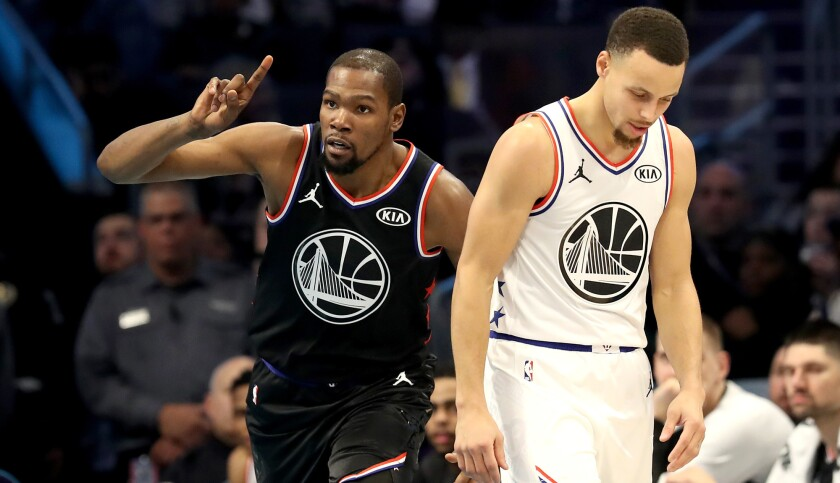 Kevin Durant of Team LeBron and Stephen Curry of Team Giannis have different reactions to a play during the NBA All-Star game.