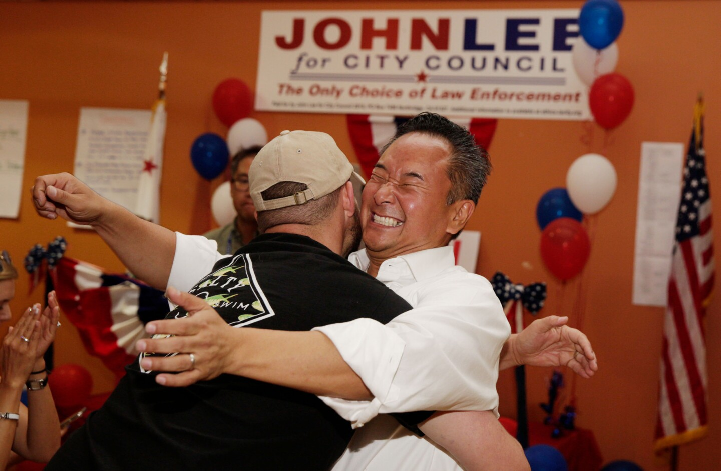 "PORTER RANCH, CALIF. - AUGUST 14, 2019: Longtime friend Erich King picks up newly elected Councilman John Lee during his election night the Los Angeles City Council District 12 on Wednesday, Aug. 14, 2019 in Porter Ranch, Calif. ""His whole life has been about city twelve, and his goal is to represent this community,"" King says. ""That's why we're on his side."" (Liz Moughon / Los Angeles Times)"