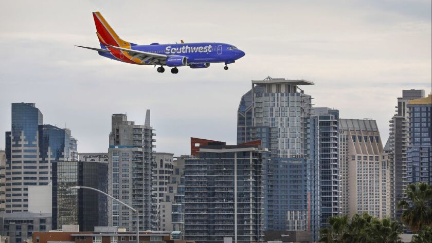 SAN DIEGO, CA 2/1/2019: A Southwest Airlines Boeing 737 passes in front of the downtown San Diego s