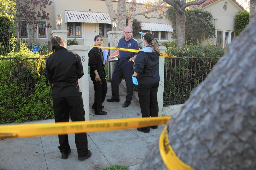Investigators outside a home in Windsor Square where an 86-year-old woman was found fatally stabbed in December.
