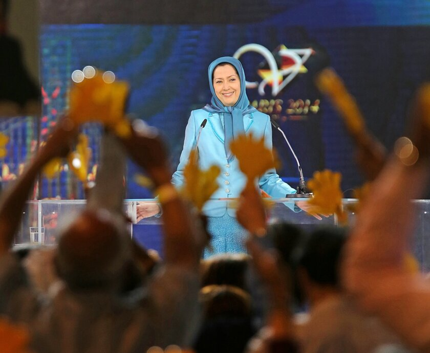 Maryam Rajavi, the leader of the National Council of Resistance of Iran,  addresses thousands of exiled Iranians in Villepinte, north of Paris, Friday June 27, 2014. (AP Photo/Rermy de la Mauviniere)
