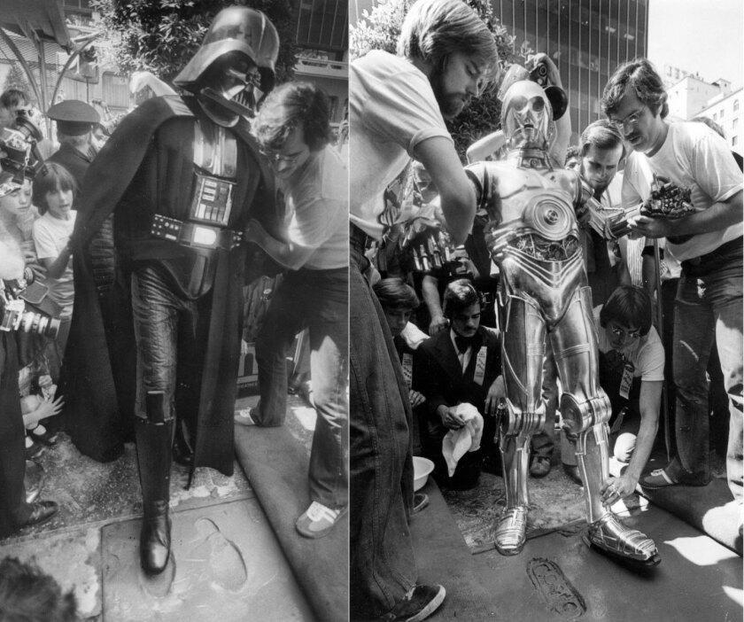C-3PO and Darth Vader add a little science fiction to the Forecourt of the Stars at the Chinese Thea