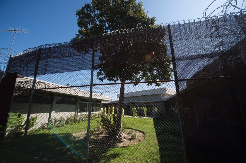 Immigration detainees walk to pick up their lunches at the Theo Lacy Facility in 2017.